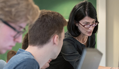 Professor Kathryn Leonard works with computer science students